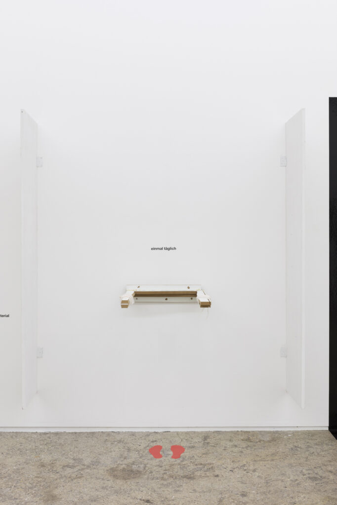 H-18.1 (Einmal täglich), 2019 • wood, bandages, adhesive foil, 110 x 57 x 69 cm