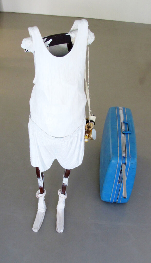 Mele Mobil, 2017 • singlet, underpants, socks, wood, suitcase, Mele utensils,  152 x 82 x 120 cm